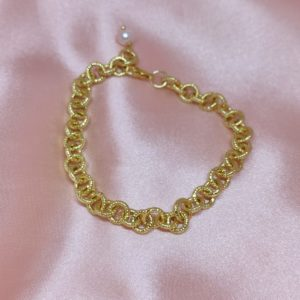 Pulsera de eslabones de circulos con baño de oro